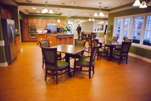 Walking through the open kitchen inside Heron Cove at Sanders, Virginia's first deinstitutionalized nursing facility